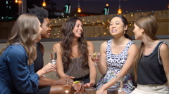 Female Friends Enjoying Night Out At Rooftop Bar, Slow Motion Stock Footage
