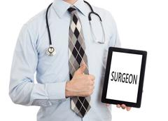 Doctor holding tablet - Surgeon - stock photo
