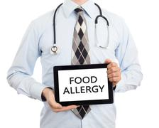 Doctor holding tablet - Food allergy Stock Photos
