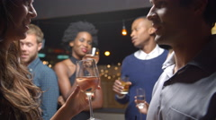 Couples Chatting And Drinking At Evening Party, Slow Motion Stock Footage