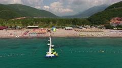 Sunbeds and parasols are on the beach. The Jaz, Montenegro Stock Footage