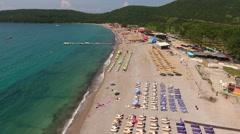 Camera flies along the Jaz beach with pebble area, Montenegro Stock Footage