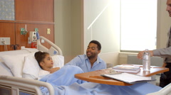 Pediatrician Visits Father And Child In Hospital Shot On R3D Stock Footage