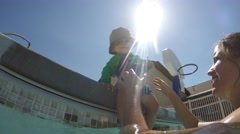 Underwater shot of mother and boy in swimming pool outside Stock Footage