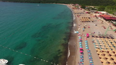 Side aerial view at the Jaz beach. Adriatic sea. Montenegro Stock Footage