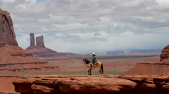 Monument Valley Young Woman Horseback Riding at John's Ford Point Stock Footage