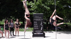Beautiful women performing pole dance Stock Footage