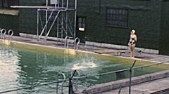 USA 1946: people having fun in an outdoor swimming pool - stock footage