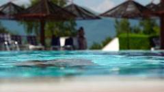 Young bikini woman dive in pool - stock footage