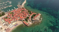 Adriatic sea with Old Town of Budva on a rocky peninsula Stock Footage