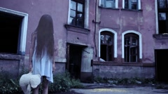 Spirit of a girl with long hair near the old mansion. baby ghost Stock Footage