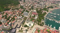 Central part of the Budva city with Mogren beach. Aerial shot. Montenegro Stock Footage