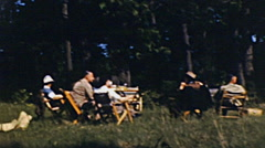 USA 1946: family having a barbecue outdoor Stock Footage