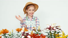 Close up portrait flower-girl in hat selling flowers - stock footage