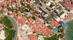 Aerial view of the Budva city and coastal road through the streets. Montenegro Stock Footage
