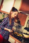 Woman frying frozen vegetables. Stir fry. - stock photo