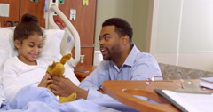 Father And Child Play With Soft Toy In Hospital Shot On R3D Stock Footage