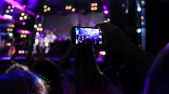 Spectator fan solhouette shooting video with smart phone of concert performance Stock Footage