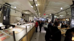 Pass over 'The Lobster Place' shop & restaurant at Chelsea Market. Stock Footage