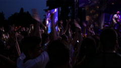 People crowd fan spectators clapping hands in air enjoying music concert Stock Footage