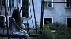 the ghost of a little girl on a swing in the old ruined house. evil spirit - stock footage