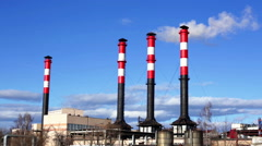 Tall chimneys in blue sky air pollution Stock Footage