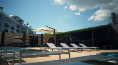 dolly shot of the luxury hotel terrace and aqua zone slow motion - stock footage