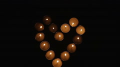 Candles in the dark exhibited by the heart Stock Footage