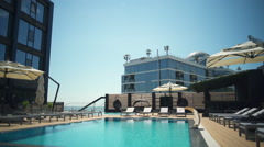 Dolly shot of the luxury hotel terrace and aqua zone slow motion Stock Footage