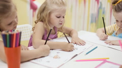 Little cute girls paint coloring book Stock Footage