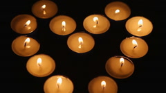candles in the dark exhibited by the heart - stock footage