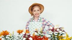 Close up portrait flower-girl in hat using sprinkler Stock Footage
