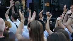 Crowd people teenager spectators fan clapping hands cheering by concert stage Stock Footage