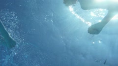 Young woman swimming under water in the swimming pool Stock Footage