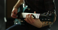Close Up Of Man Playing Electric Guitar Shot On R3D Stock Footage
