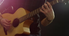 Close Up Of Man Playing Acoustic Guitar Shot On R3D Stock Footage