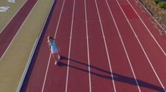 Aerial of Female Athlete Walking On Track - stock footage