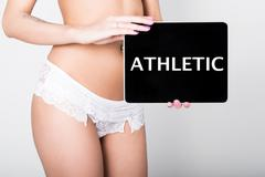 technology, internet and networking - close-up ass of girl in lacy lingerie - stock photo