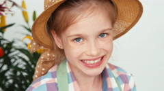 Close-up portrait child girl in hat sitting and drawing butterfly Stock Footage