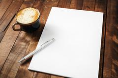 Letterhead, coffee cup and pen Stock Photos