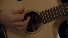 Slow Motion Shot Of Man Playing Acoustic Guitar Stock Footage