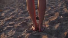 woman walking on beach barefoot sunset steadicam shot - stock footage