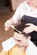 Handsome man in hairdressing saloon Stock Photos
