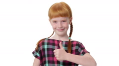 Redhead girl with two pigtails is showing thumb up gesture Stock Footage