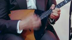 Russian artist playing balalaika, close up. Stock Footage