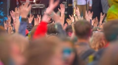 crowd of happy people at concert dancing and waving hands - stock footage