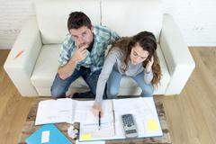 Young worried stressed couple at home doing domestic debt accounting tax Stock Photos