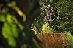 BMX rider performing stunt mid air - stock photo