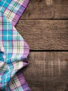 Table cloth on wood - stock photo