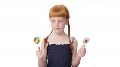 Little ginger girl with  lollypops - stock footage